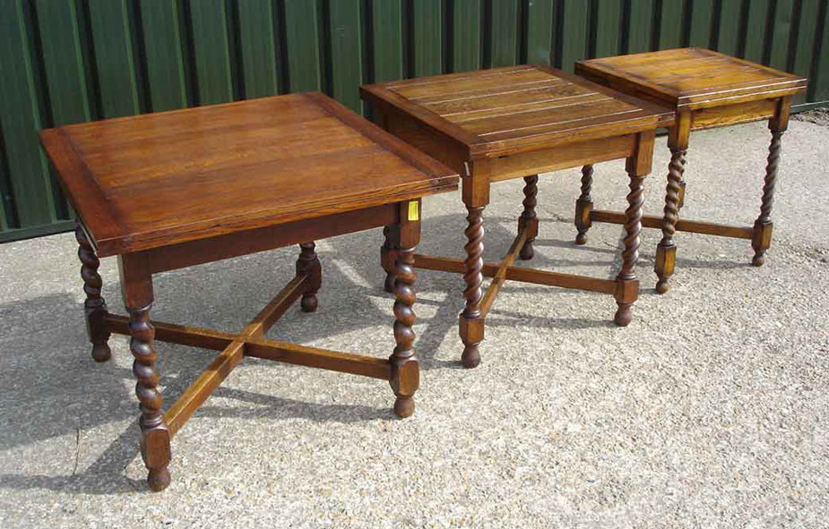 Photo showing 3 different sized draw leaf tables